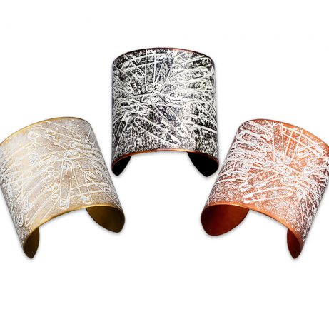 Can't Pin It On Me! Cuffs in (from left) Golden Brass, Blackened Copper, and Flame Red Copper