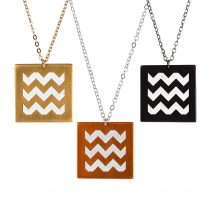 Square En ZigZag Pendants in (from left) Golden Brass, Flame Red Copper, and Blackened Copper