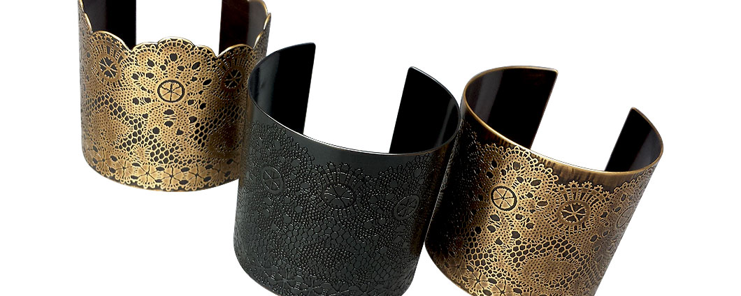 Lacy Cuffs in (from left) Antique Brass with handcut edge, Blackened Brass, and Antique Brass
