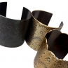 Lacy Cuffs in (from left) Blackened Brass, Antique Brass, and Antique Brass with hand-cut edge