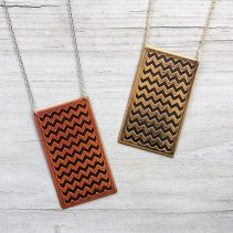 En ZigZag Necklaces in Antique Copper (left) and Antique Brass