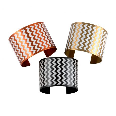 En ZigZag Cuffs in Flame Red Copper/White (top left), Golden Brass/White (top right), and Blackened Copper/White (bottom)