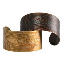 Narrow Faux Bois Cuffs in Golden Brass (bottom left) and Blackened Copper (top right)