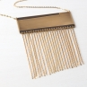 Fringe It! Necklace featuring an etched brass pendant with gold plated chain fringe.