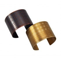 Gridded Cuffs in Blackened Copper (top left) and Golden Brass (bottom right)